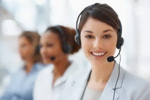 Closeup of a cute business woman with headset at workplace